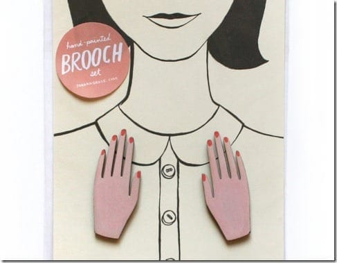 two-hand-brooches