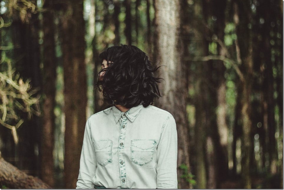 woman-hidden-by-hair-in-nature