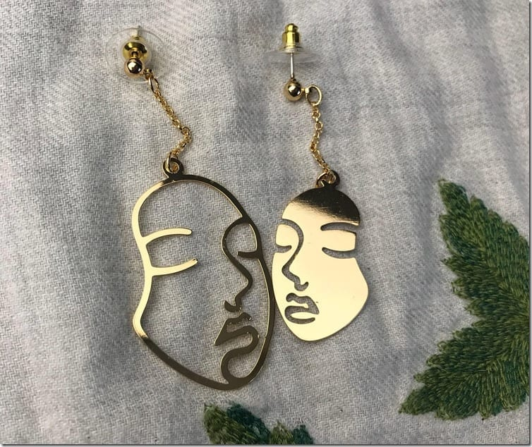 hollowed-out-face-earrings
