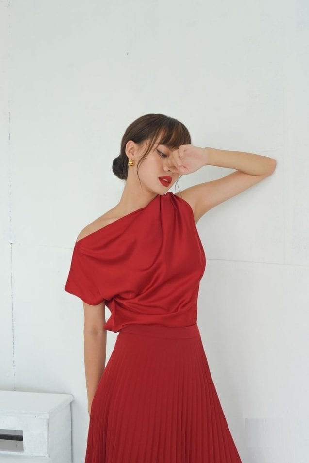 Asymmetric sleeve red boat neck silk top