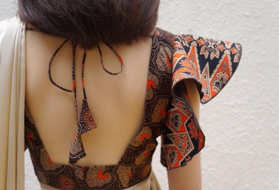 The exquisite back design of a tailored batik saree blouse